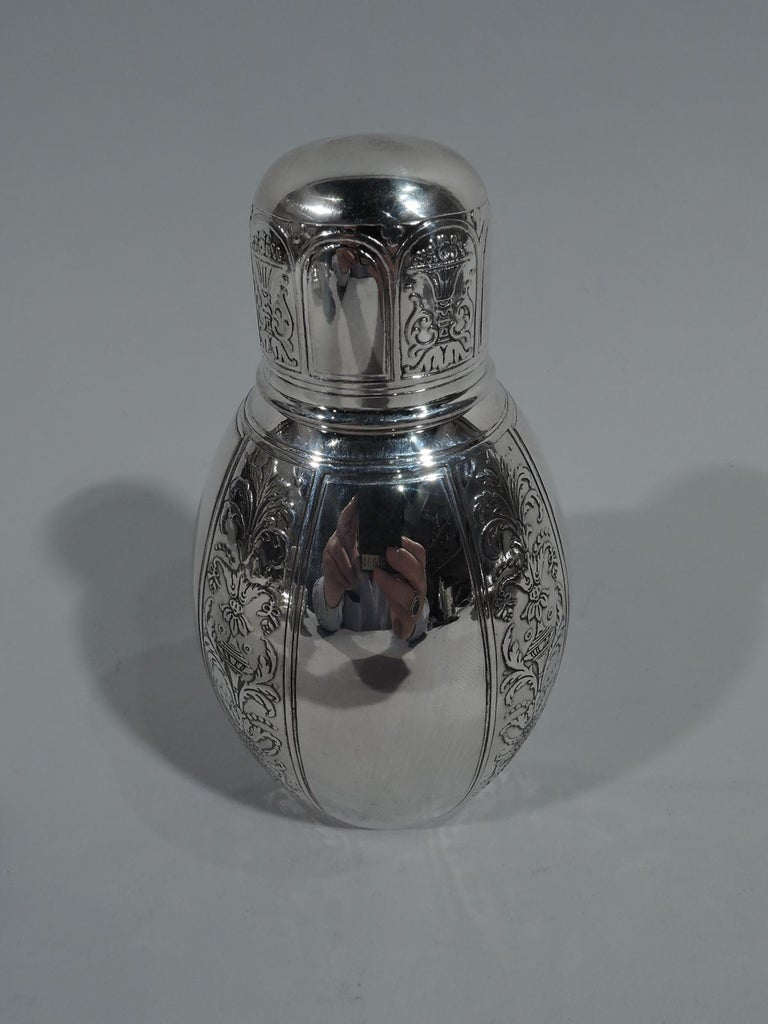 Renaissance-Revival sterling silver tea caddy. Made by Tiffany & Co. in New York, circa 1910. Ovoid with short neck and snug-fitting cover. Vertical ornament in form of alternating wide plain bands and narrow acid-etched ones with Grotesque
