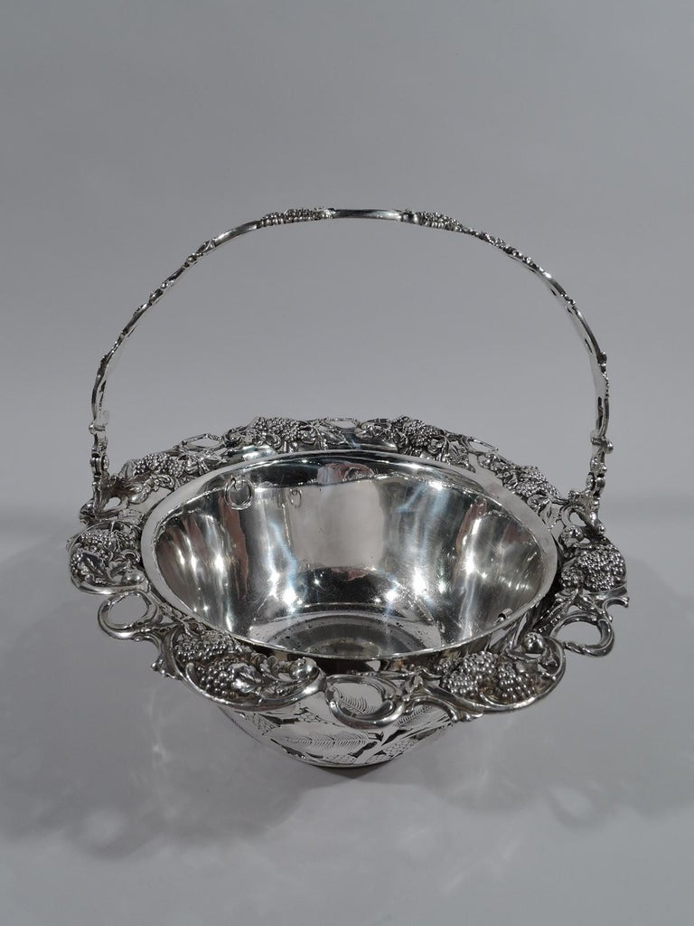 Charming sterling silver basket with blackberry motif. Made by Tiffany & Co. in New York. Plain and solid well. Curved and open sides comprising fruiting blackberry branches heightened with engraving. Open and scrolled rim with more succulent fruit