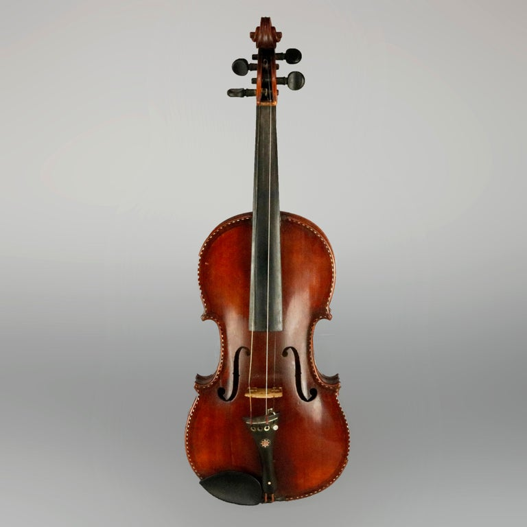 Victorian tiger maple violin with ebonized mother of pearl herringbone inlay, case, original label reads Vincent Panormo as photographed, circa 1850.  Measures: 23.75