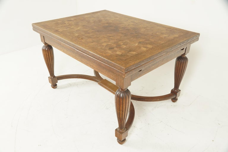 Antique tiger oak table, parquetry pull out refectory table, France 1920, B2741  France 1920 Solid oak Original finish Oak parquetry top Pair of plain hidden tiger oak leaves that pull out to extend the table All standing on turned tapering