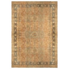 Antique Traditional Kerman Lavar Blue and Brown Rug with All-Over Floral Pattern