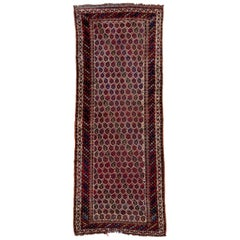 Antique Tribal Persian Kurd Runner, circa 1900s, All-Over Field, Medium Pile