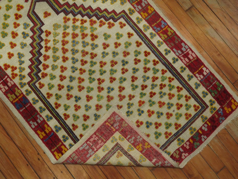 Early 20th century Turkish ghiordes prayer rug. Very colorful and petite.