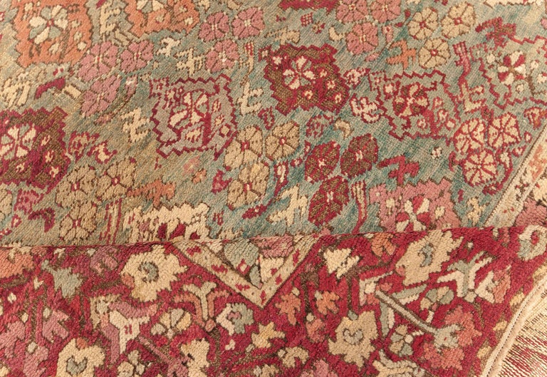 Hand-Knotted Antique Turkish Ghiordes Rug 'Size Adjusted' in Beige, Green, Orange, Pink & Red For Sale