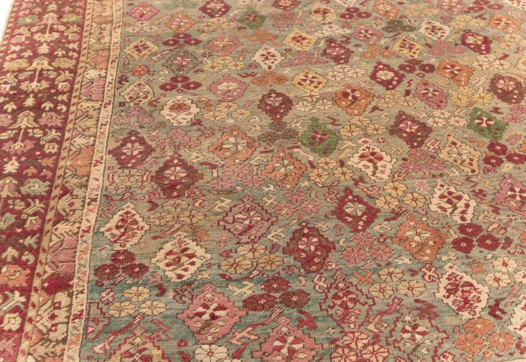 Antique Turkish Ghiordes Rug 'Size Adjusted' in Beige, Green, Orange, Pink & Red In Good Condition For Sale In New York, NY