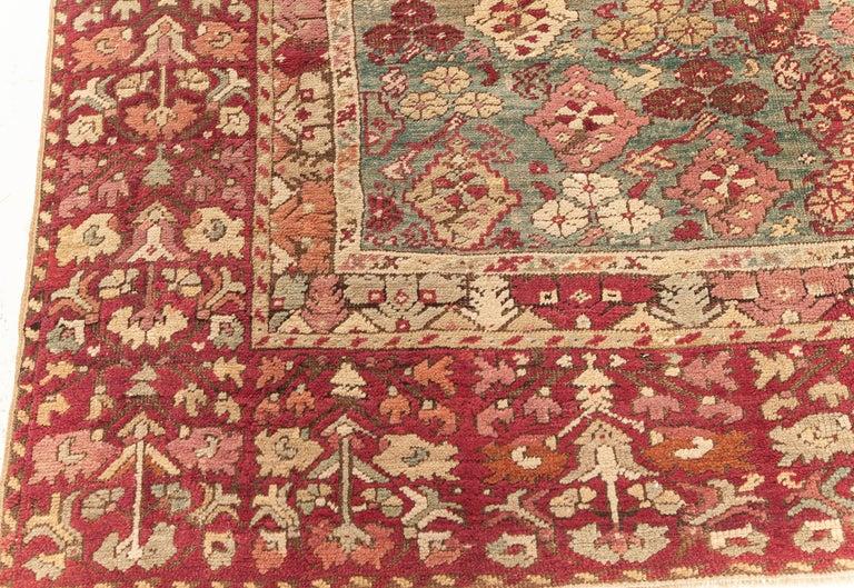 20th Century Antique Turkish Ghiordes Rug 'Size Adjusted' in Beige, Green, Orange, Pink & Red For Sale
