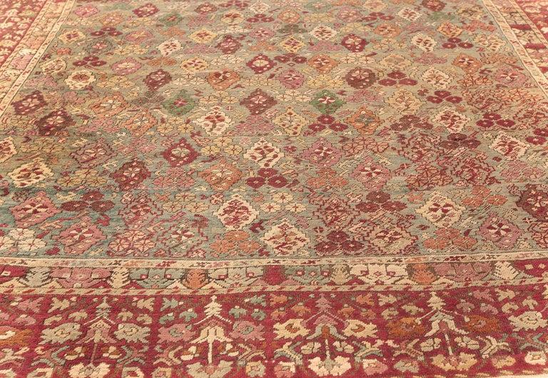 Wool Antique Turkish Ghiordes Rug 'Size Adjusted' in Beige, Green, Orange, Pink & Red For Sale