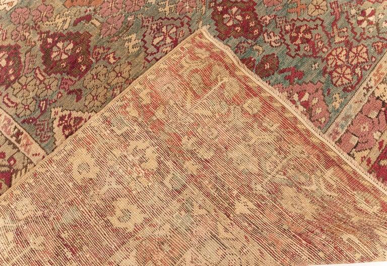 Antique Turkish Ghiordes Rug 'Size Adjusted' in Beige, Green, Orange, Pink & Red For Sale 1