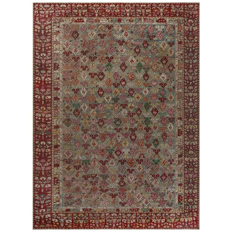 Antique Turkish Ghiordes Rug 'Size Adjusted' in Beige, Green, Orange, Pink & Red For Sale