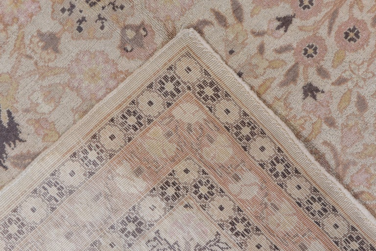 Tribal Antique Turkish Hereke Rug, Ivory Field, Pink & Navy Accents, Circa 1930s For Sale