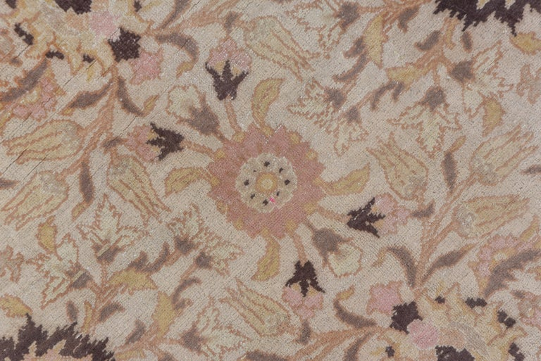 Wool Antique Turkish Hereke Rug, Ivory Field, Pink & Navy Accents, Circa 1930s For Sale