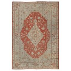 Antique Turkish Oushak Carpet with Soft Orange Ground and Floral Motifs