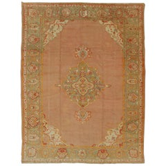 Antique Turkish Oushak in Pink Background and Light Green Border