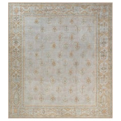 Antique Turkish Oushak Rug in Beige, Blue, Gold, and Pink