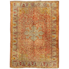 Antique Turkish Oushak Rug in Salmon, Light Green, Red and Butter Yellow