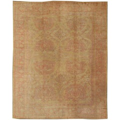 Antique Turkish Oushak Rug with Large Floral Motifs in Cream Yellow, Muted Coral