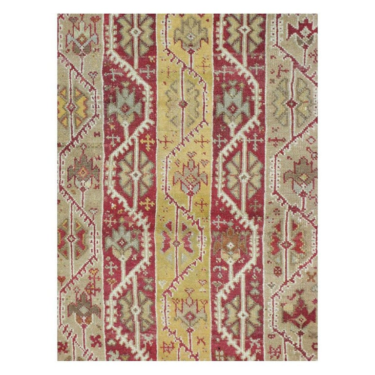 An antique Turkish Oushak room size rug in square format handmade during the early 20th century with a vertical cane design (pole design).  Measures: 11' 9