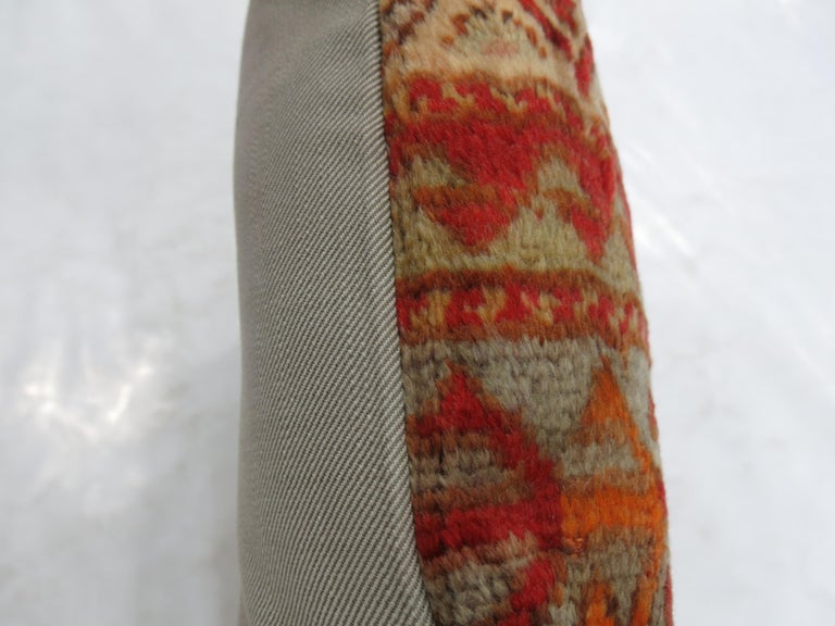 """Pillow made from an antique Turkish Sivas rug in predominant coral accents. Measures: 20"""" x 20""""."""