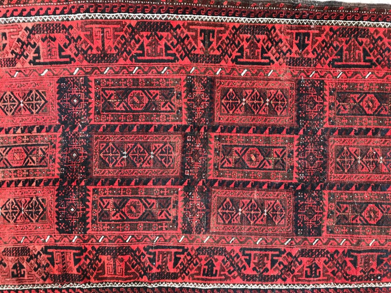 Beautiful late 19th century Baluch rug with nice natural colors and tribal geometrical design, wool velvet on wool foundation.