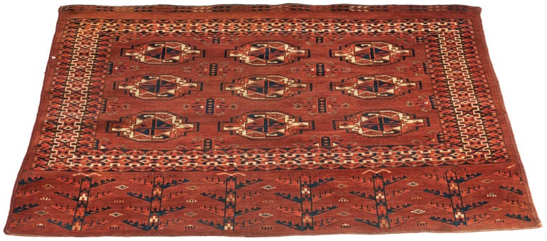 Originally woven as the face of a bag. Made by the nomadic tribes of Turkmenistan. Very finely knotted.