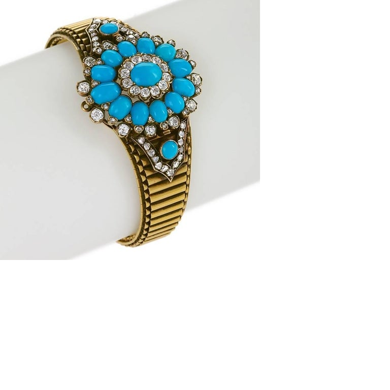 An Antique 18 karat gold bracelet with turquoise and diamonds. The bracelet has 24 Old Mine-cut diamonds with an approximate total weight of 1.50 carats, 50 rose-cut diamonds with an approximate total weight of .70 carat, and 15 turquoise cabochons.