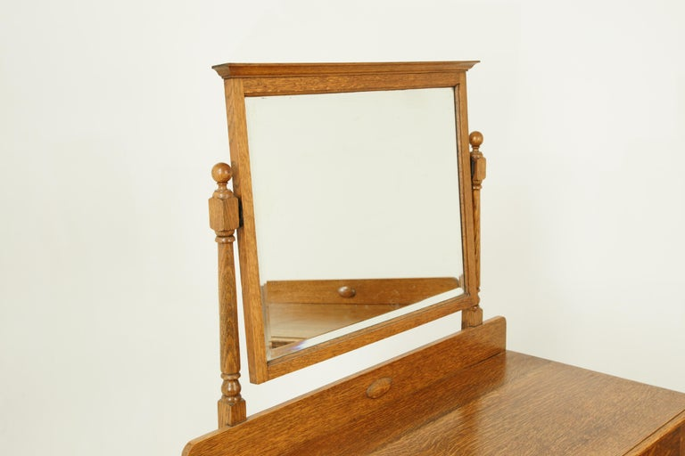 Antique vanity, antique dresser, beveled mirror, tiger oak, Scotland, 1930, antique furniture  Scotland, 1930 Solid oak construction Recently refinished Mirror above tilts forward and backwards Molded top Below are three-dovetailed drawers with