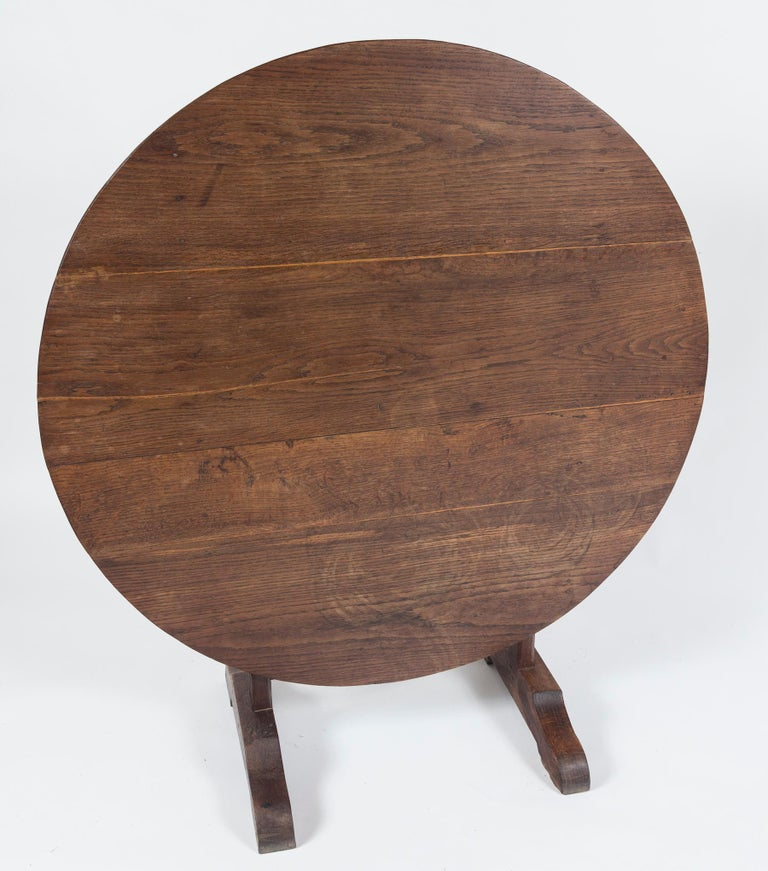 Antique Vendange (Wine Tasting) table, late 19th century, France. Beautifully aged oak with doweled construction. Vendange tables were used in the cellars of the vineyards in France, designed with a tilt-top mechanism for storage.