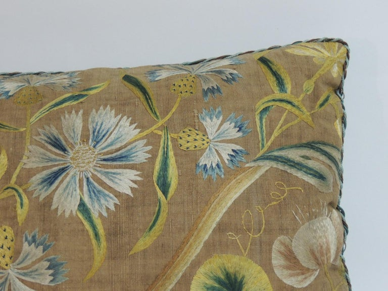 Antique Venetian floral embroidered large bolster decorative pillow. Italian floral silk floss thread embroidered on linen. In shades of yellow, green, white, pink and blue. Silk green velvet backing and ATG decorative twisted trims all