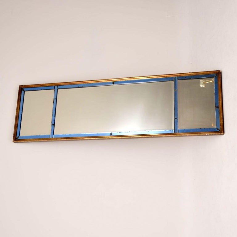 Antique mirror in three sections with blue mirror banding set in a giltwood frame. I'm not sure of the exact age but it looks to me from the late 19th century or possible early 20th century. It's quite large and can be hung either way, which is