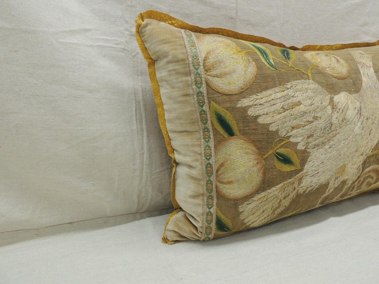 Antique Venetian gold and green floral embroidered bolster decorative pillow. Italian floral silk floss thread embroidered on linen. Embellish with antique gold trim. Framed with antique strie tan tone-on-tone silk velvet panels. In shades of