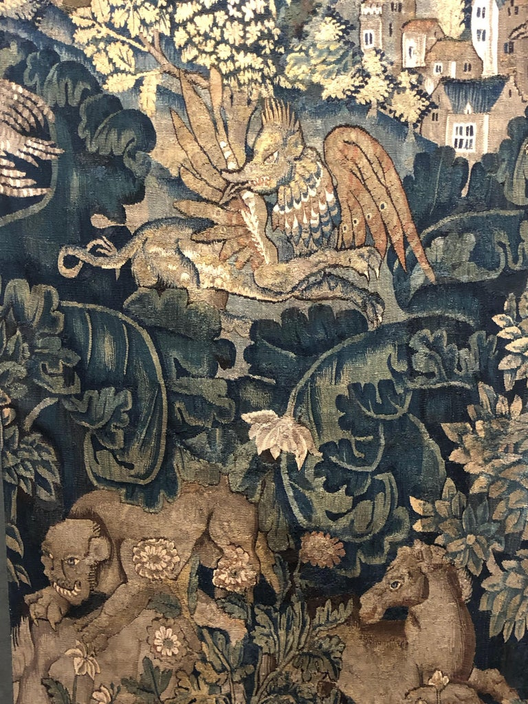 16th century Flemish Verdure Feuilles de Choux tapestry panel.  Feuilles de Choux (trans. cabbage leaves) tapestry include large leaves in an overall, often wild motif with animals of the hunt or exotic creatures admired for their beauty and