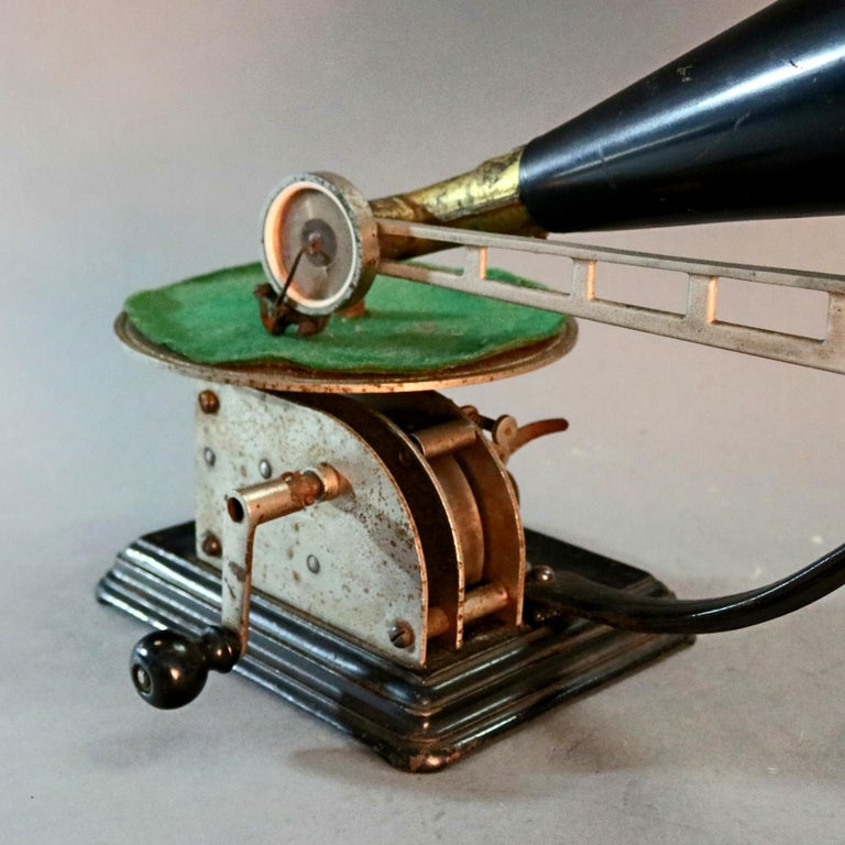 An antique Victor Victrola School clockwork phonograph music machine includes crank and horn, circa 1890.  Measures - 15.25