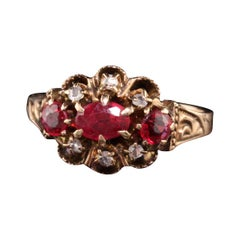 Antique Victorian 12K Rose Gold Ruby and Diamond Three Stone Ring