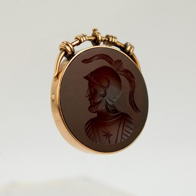 A very fine Victorian carnelian and gold pendant or charm.  With a carved intaglio of an ancient Roman soldier set in 14 karat gold.  Simply a fine piece!  Date: 19th Century  Overall Condition: It is in overall good, as-pictured, used estate