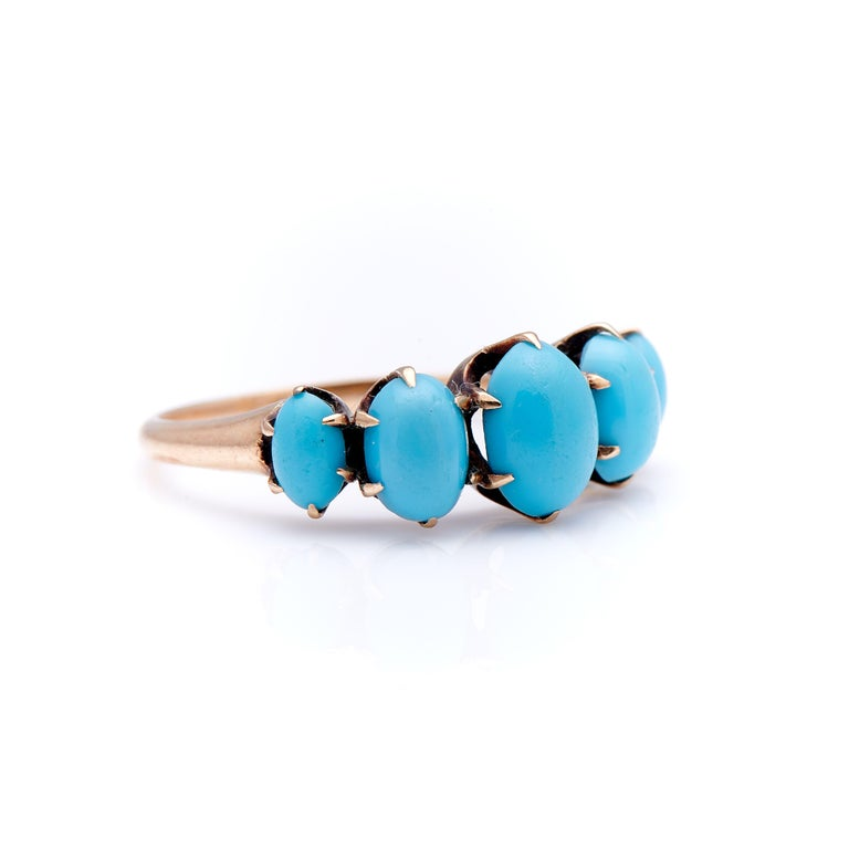 Victorian, turquoise five stone ring, circa 1890. Set with five beautiful robin-egg hue cabochon turquoise stones in a simple but beautifully executed yellow gold setting. Each piece of natural turquoise is well matched and secured by curving carved