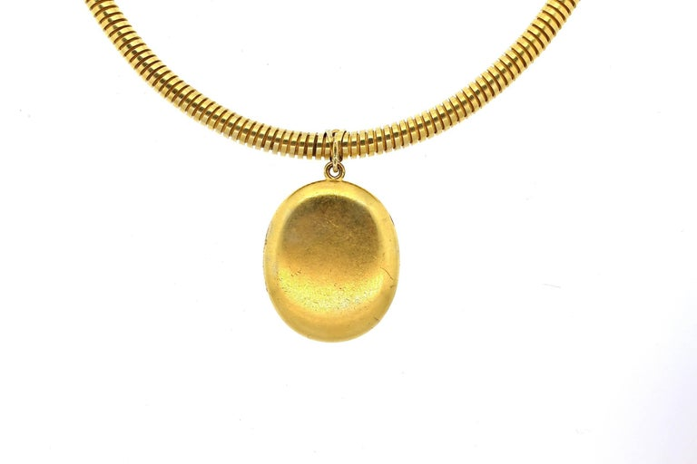 Original 14k gold gas pipe necklace suspending a locket with a ruby horseshoe made in Russia circa 1860.  The Russian maker is Leopold Karlovich who was a Russian Court jeweler in the 1850s and 1860s.  Though a little known maker, he indeed made