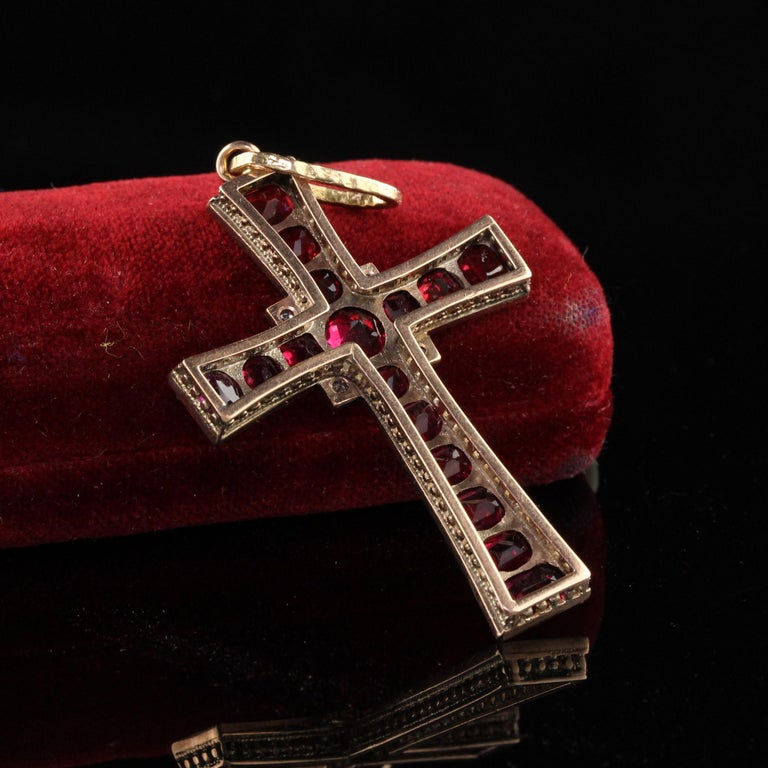 Gorgeous Antique Victorian 14K Yellow Gold Colored Gemstone Cross Pendant. This gorgeous cross features red gemstones that we believe to be synthetic rubies and rose cut diamonds.  Item #N0055  Metal: 18K Yellow Gold  Diamonds: Approximately .10