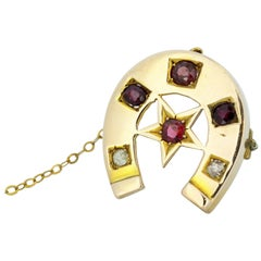 Antique Victorian 15 Karat Gold Horseshoe Brooch, Rubies and Diamonds, 1880s