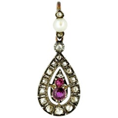 Antique Victorian 15 Karat Gold and Sterling Silver Pendant, Rubies and Diamond