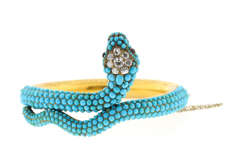 A rare antique Victorian turquoise, and diamond snake bangle bracelet, circa 1880. This bracelet hinges open, the hollow form gold back is beautifully engraved. The top part of the bracelet is set with pave turquoise that are in great condition. The