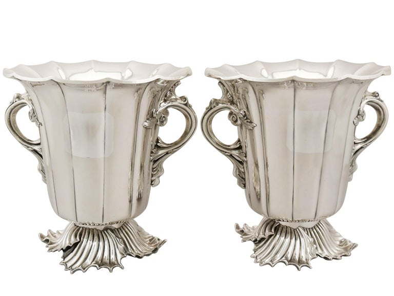 An exceptional pair of antique Victorian English old Sheffield plate wine coolers; part of our antique wine / drink related silverware collection  These exceptional antique Victorian old Sheffield plate* wine coolers have a tapering panelled