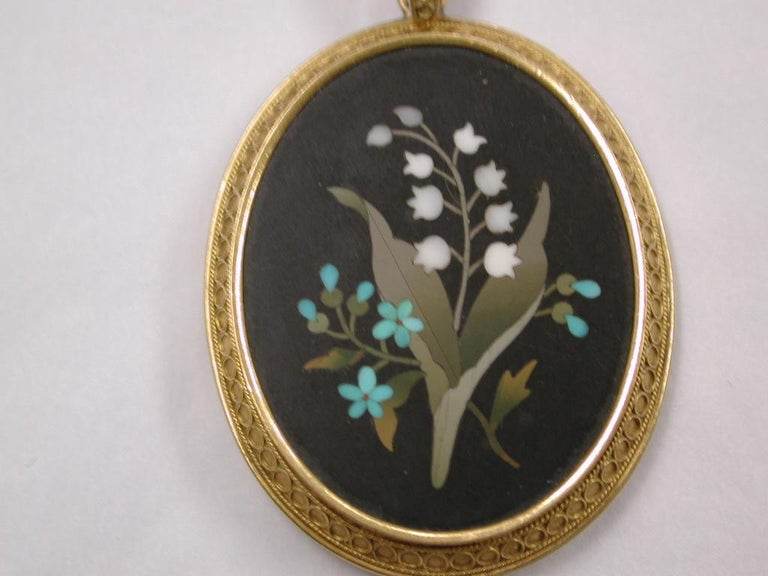 Antique Victorian 18ct Etruscian Bordered Pietra Dura Pendant,dated circa 1880. This pendant is a good example of fine quality pietra dura with a hinged gold and glass back, for photos or hair. Probably made in Florence, Italy