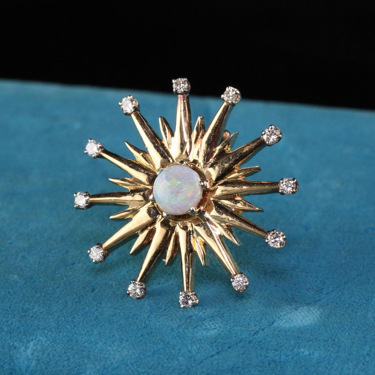 Gorgeous Vintage 18K Yellow Gold Black Opal and Diamond Star Burst Pin Pendant. This gorgeous Black Opal piece can be worn as either a pin or a pendant. It features 12 smaller diamonds and a beautiful round black opal in the center. Very very