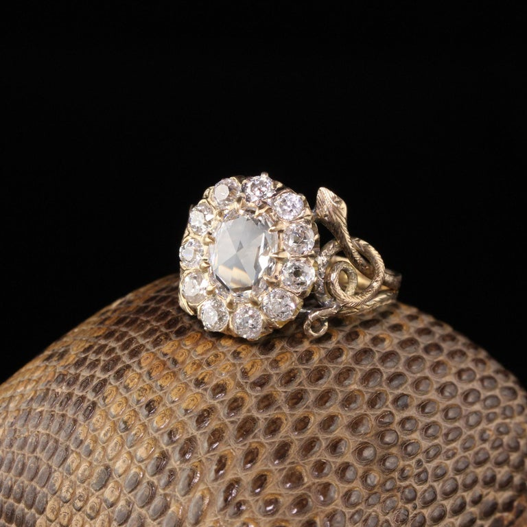 Stunning Victorian Diamond engagement ring with approximately 2 cts of Old Mine Cut and a center rose cut diamond.  #R0433  Metal: 18K Yellow Gold  Weight: 3.8 Grams  Total Diamond Weight: Approximately 2 CTS  Center Diamond Weight: 0.84 CTS - GIA