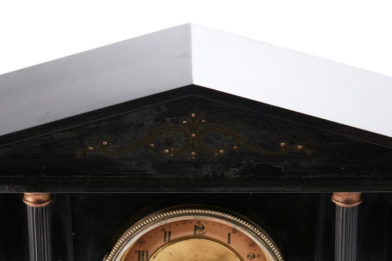 Antique Victorian 8 Day Marble Mantle Clock having an architectural top supported by 6 Corinthian columns. 8 day movement with brass dial standing on a plinth base. Perfect working order and original key.