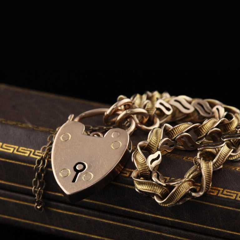 Beautiful Antique Victorian 9K Yellow Gold Heart Lock Bracelet. This beautiful bracelet is in great condition and the heart acts as a lock for the bracelet.   Item #B0037  Metal: 9k Yellow Gold  Weight: 12.2 Grams  Measurements: 7 inches