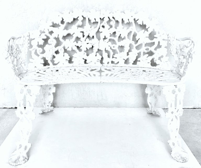 Antique Victorian American Berry, leaf & vine motif, three foot cast iron curved bench. This heavy duty bench, painted white with a shabby chic finish has a 14
