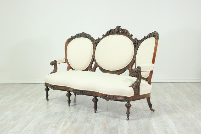 American Antique Victorian Carved Mahogany Sofa For Sale