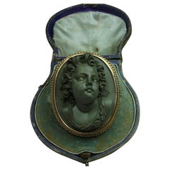 Antique Victorian Cased Lava Stone Front Face Cupid Cameo Brooch