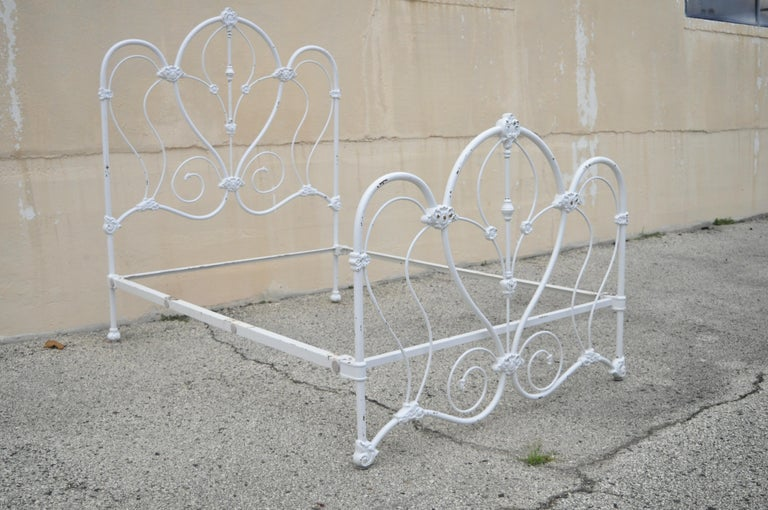 Antique Victorian cast iron ornate white scrollwork full size metal bed frame. Item features heavy cast iron frame, white lacquered finish, ornate scrollwork, full size frame, quality American craftsmanship, great style and form, mid-20th century.